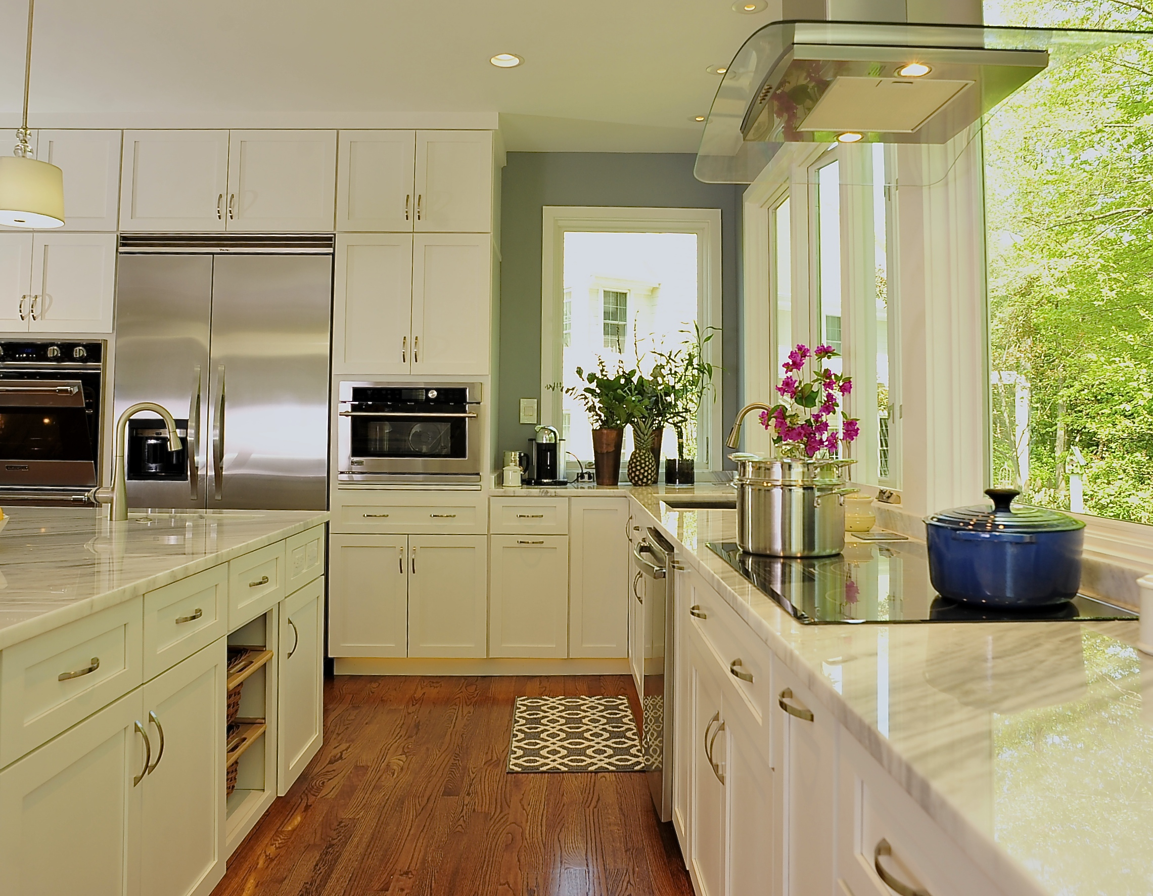 A clean kitchen is designed to be open with a well thought out work triangle and plenty of cabinet storage.